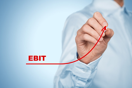 profitability: EBIT (Earnings before interest and tax) increase concept. Businessman draw graph with growing EBITDA. Stock Photo