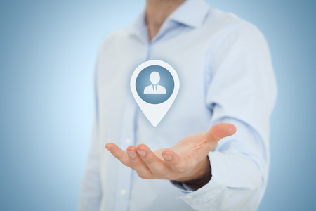 Target customer and human resources (HR) concept. Businessman hold target customer, employee (or another business person) in hand. Central composition. Stock Photo