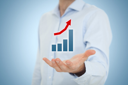 illustrating: Businessman hold graph illustrating positive progress and success.