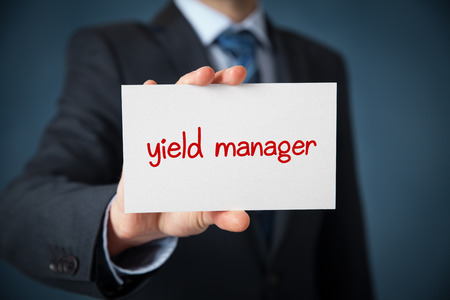yield: Yield manager advertisement (self-propagation) concept. Man show card with text yield manager.
