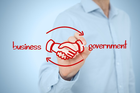 purchasing: Business to government (B2G) concept - business model. Businessman (lobbyist) draw scheme with handshake partnership agreement.
