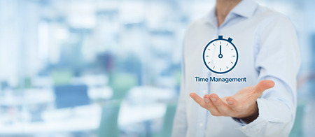 Time management and deadline concept. Businessman with clock watch expecting deadline. Wide banner composition with out of focus office in background.