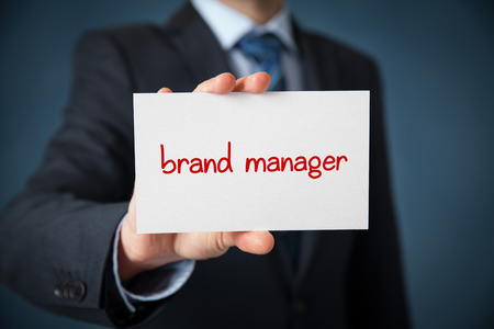 identity management: Brand manager advertisement (self-propagation) concept. Man show card with text brand manager. Stock Photo