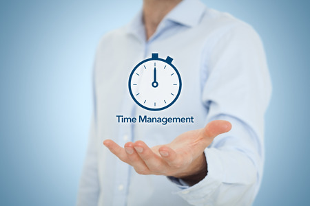 Time management and deadline concept. Businessman with clock watch expecting deadline. Central composition. photo