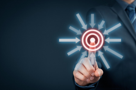 target: Marketing targeting, goal and trigger concepts. Businessman click on virtual target. Stock Photo