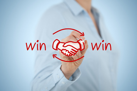 partnership strategy: Win-win partnership strategy concept. Businesswoman draw win-win scheme with handshake partnership agreement.