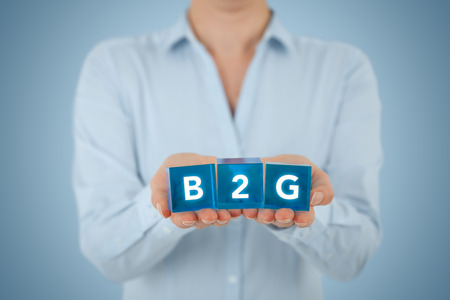 lobbying: Business to consumer (B2G) concept. Businesswoman offer B2G solution represented by blue cubes.