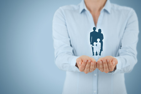 family policy: Family life insurance, family services and supporting families concepts. Businesswoman with protective gesture and silhouette representing young family.