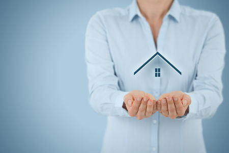 Property insurance and security concept. Protecting gesture of man and symbol of house.