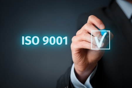 iso: ISO 9001 - quality management system. Businessman select ISO 9001 certification.