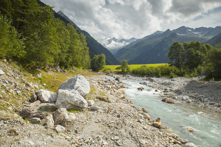tirol: Austrian Tirol Alps landscape with mountains, forests, meadows and brook. Stock Photo