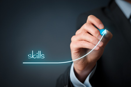 experience: Skills improvement concept. Businessman draw rising curve of skills. Stock Photo