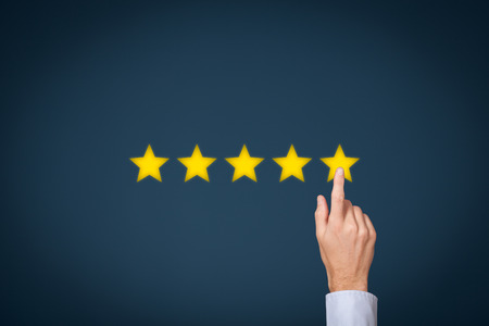 five stars: Increase rating, evaluation and classification concept. Businessman click on five yellow stars to increase rating of his company. Stock Photo