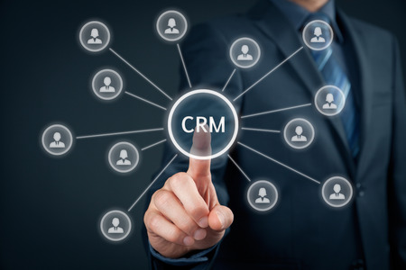 managerial: Customer relationship management (CRM) concept. Businessman click on button with text CRM, linked with customers. Stock Photo