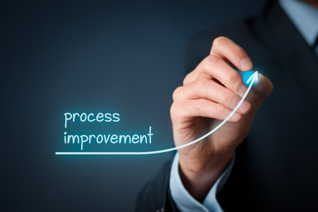 Process improvement concept. Businessman draw growing line symbolizing growing process improvement. 스톡 콘텐츠