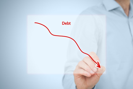 debt: Debt reduction business concept. Businessman draw simple graph with descending curve.