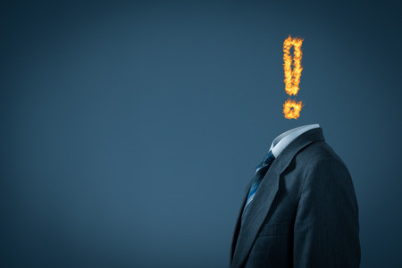 burned out: Burnout syndrome metaphor. Businessman with exclamation mark in fire instead of head. Stock Photo