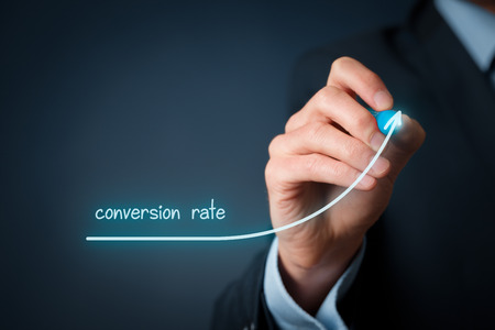internet marketing: Conversion rate (internet marketing) concept. Businessman (marketer) draw growing graph of rise conversion rate.