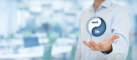 Work life (work-life) balance concept. Life coach (career manager) give advice about work-life balance, wide composition with office in background.