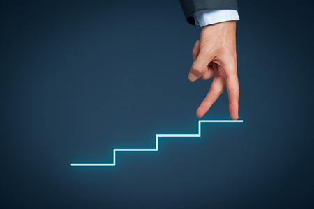 leadership qualities: Manager (businessman, coach, leadership) has success and want to growth further. Growth and personal development represented by stairs. Stock Photo