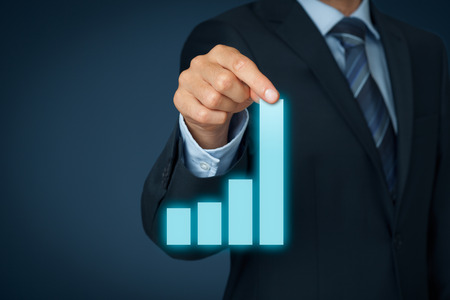 profit: Businessman pull column of graph to improve business progress and success.