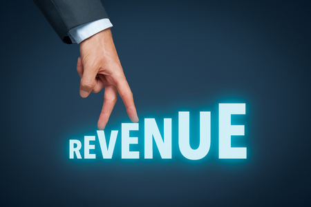 Increase revenue concept. Businessman represented by hand rise on increasing letters on word revenue.