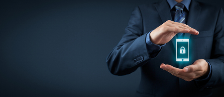 Mobile device (mobile phone, cellphone, tablet) security concept. Protecting gesture of businessman and symbol of mobile device with padlock. Wide banner coposition.