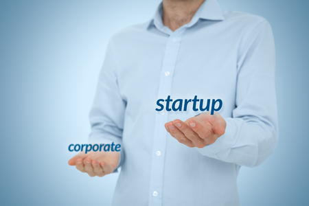to prefer: Startup versus corporate business concept. Young businessman (or employee) prefer startup company against corporation. Career coach advice to be startup employee. Stock Photo
