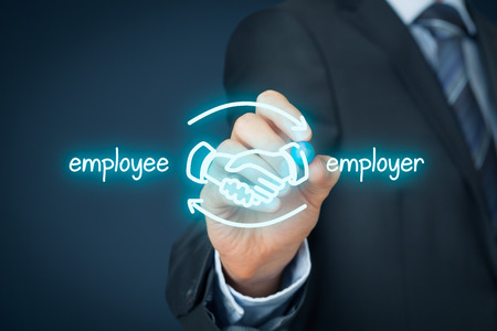 employees: Employee and employer balanced cooperation concept. Businessman (human resources officer) draw scheme with hand shaking of employee and employer.