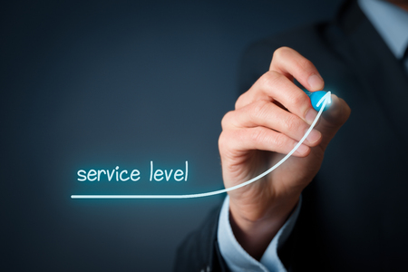 getting better: Service level and customer care improvement concept. Businessman draw growing graph with text service level. Stock Photo