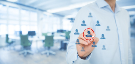 favoritism: Marketing segmentation and targeting, personalization, individual customer care (service), CRM and leader concepts. Human resources officer select one person, office out of focus in background, wide (banner) composition. Stock Photo