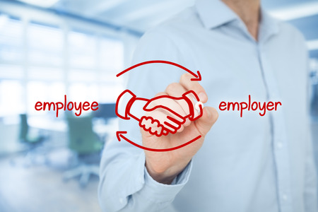 compensate: Employee and employer balanced cooperation concept. Businessman (human resources officer) draw scheme with hand shaking of employee and employer. Wide banner composition with office in background. Stock Photo