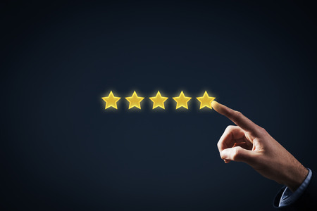 classification: Increase rating, evaluation and classification concept. Businessman represented by hand rise on increasing five stars.