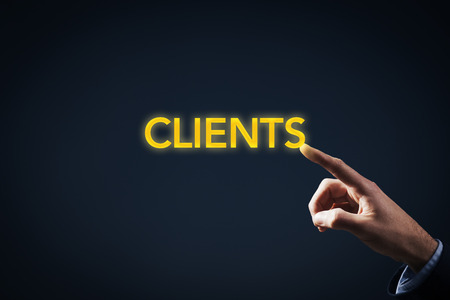 managerial: Be in touch (have contact) with clients concept. Key account manager or marketing specialist has a magic touch to work with clients. Businessman touch on gold text clients. Stock Photo