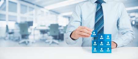crm: Human resources, social networking, assessment center concept, personal audit or CRM concept - recruiter complete team by one person. Stock Photo