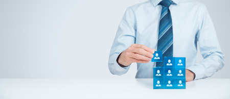Employees are represented by blue glass cubes with icons. Wide banner composition.
