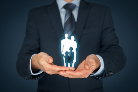 Family life insurance, family services, family policy and supporting families concepts. Businessman with protective gesture and silhouette representing young family. Central composition.