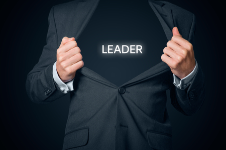 boastful: Confident leader, CEO and leadership concept. Boastful manager with opened suit and text leader instead body. Stock Photo