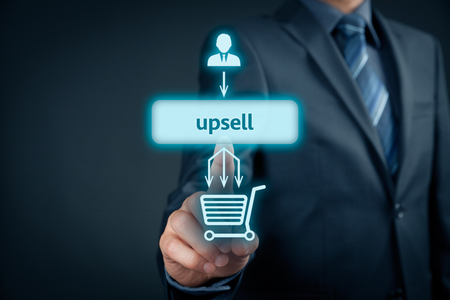 Upsell on-line (e-shop) marketing concept. Sales technique for more profitable sale. Businessman click on upsell button.