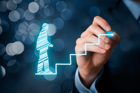 human development: Personal development, personal and career growth, success, progress and potential concepts. Coach (human resources officer, supervisor) help employee with his growth symbolized by stairs, bokeh in background. Stock Photo