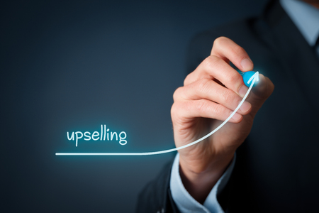 Upselling on-line (e-shop) marketing concept. Sales technique for more profitable sale. Businessman draw growing profit graph thanks upselling. Stock Photo