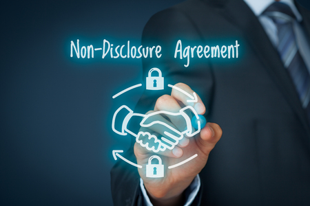 trade secret: Non-Disclosure Agreement (NDA) business concept. Businessman draw scheme representing Nondisclosure Agreement.