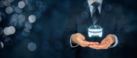 Car (automobile) insurance and car services concept. Businessman with offering gesture and icon of car. Wide banner composition with bokeh in background.