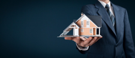 reside: Real estate agent offer house represented by model. Wide banner composition.