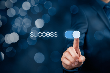 switch: Success in business concept. Businessman (mentor, coach) switch over success, bokeh in background.