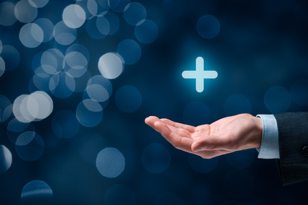 Businessman offer positive thing (like benefits, personal development, social networking) represented by plus sign, bokeh in background. 写真素材