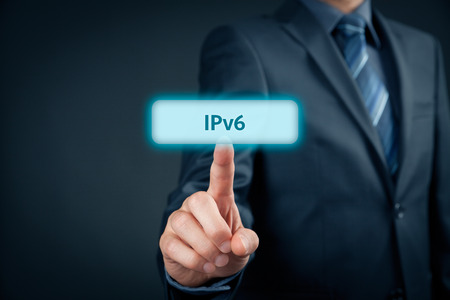tcp: IPv6 - Internet Protocol version 6, businessman click on virtual button with IPv6 text. Stock Photo