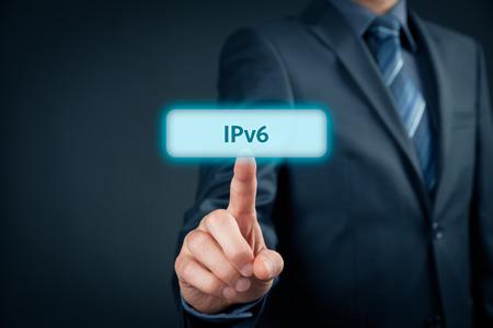 tcp ip: IPv6 - Internet Protocol version 6, businessman click on virtual button with IPv6 text. Stock Photo