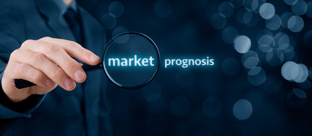 prognosis: Market prognosis concept. Businessman focused on market prognosis. Wide banner composition with bokeh in background.