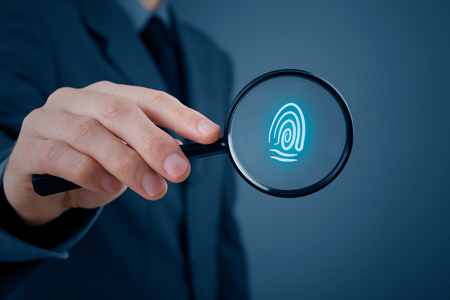 security man: Privacy policy and security concepts. Businessman with magnifying glass enlarge symbol of fingerprint.
